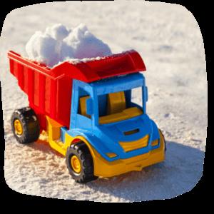Müllauto mit Schnee beladen